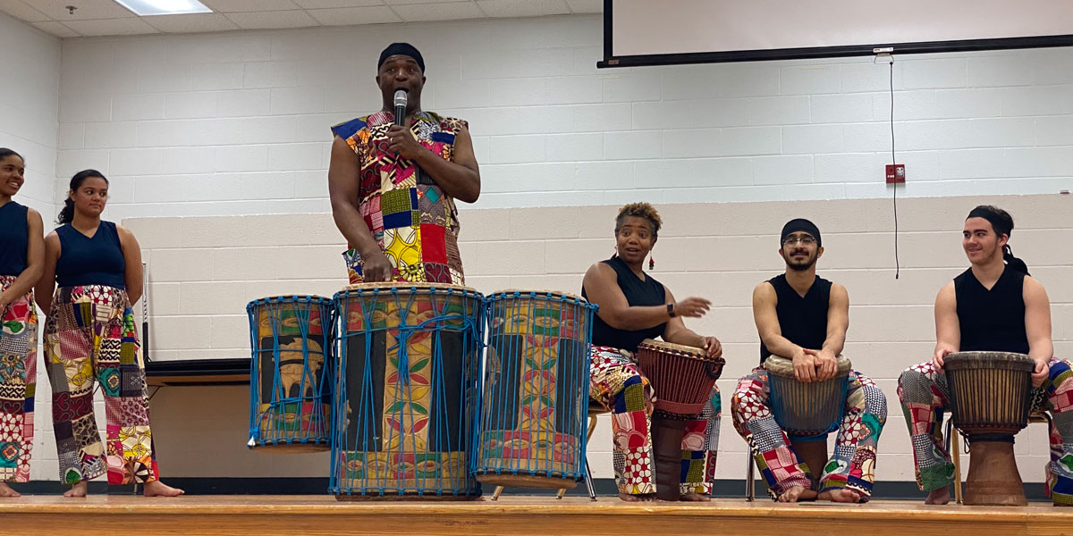Sherone Price and ensemble perform for students
