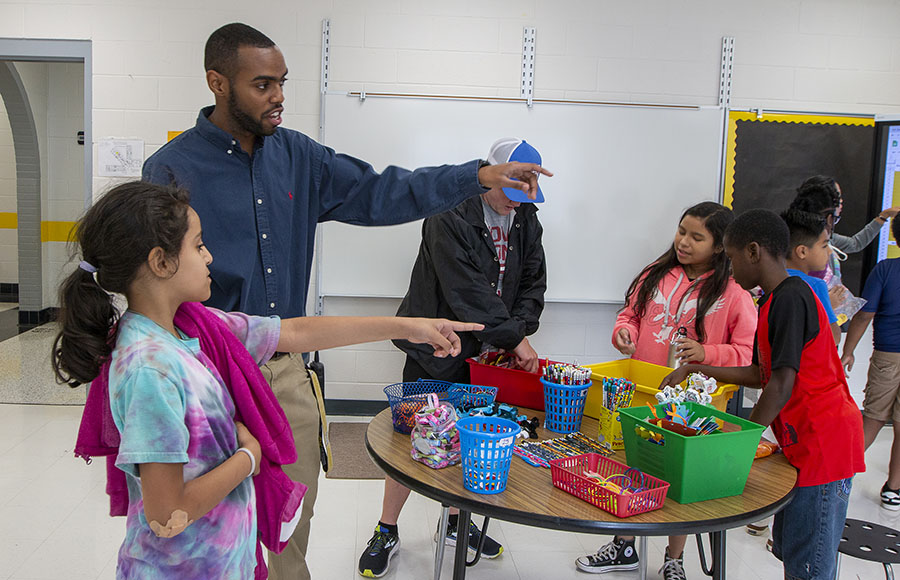 Darron Daniels supervises students at the Appalachian Academy at Middle Fork as they redeem positive behavior tokens for school supplies and treats. Photo submitted