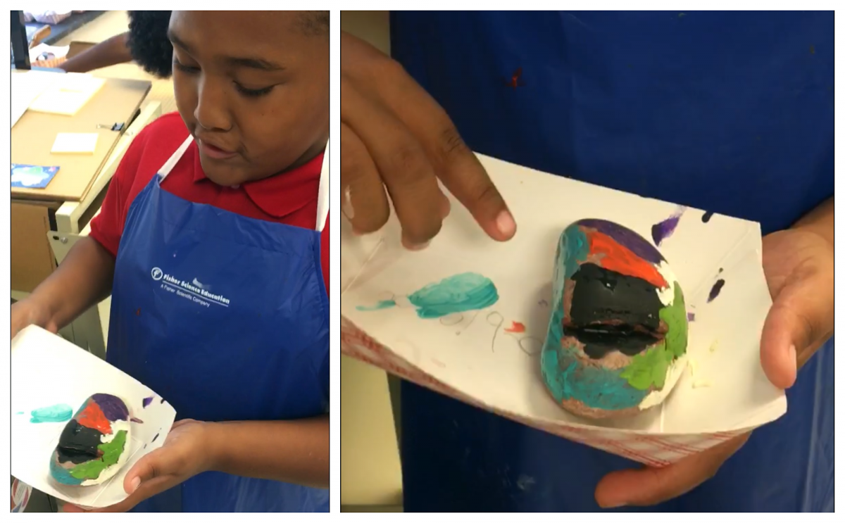Academy third grader, Delande Hawkins, explains the meaning of the colors he selected for his identity rock. Photo submitted