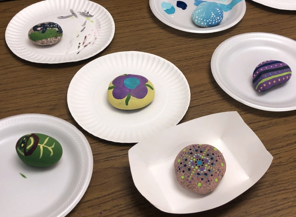 Identity Rocks painted by Academy students, faculty and staff. Photo submitted
