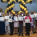 A group of fifth grade graduates of the Appalachian State University Academy at Middle Fork in Walkertown display the HIKE (honesty, integrity, kindness and excellence) awards they received at the academy's graduation ceremony held Thursday, June 6. Photo by Troy Tuttle