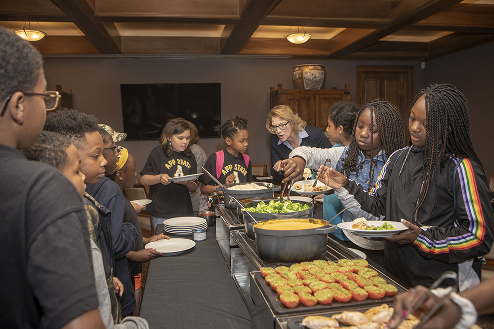 The Academy's student council members and the Academy Ambassadors enjoy lunch at the Appalachian House with Chancellor Everts. Photo by Marie Freeman