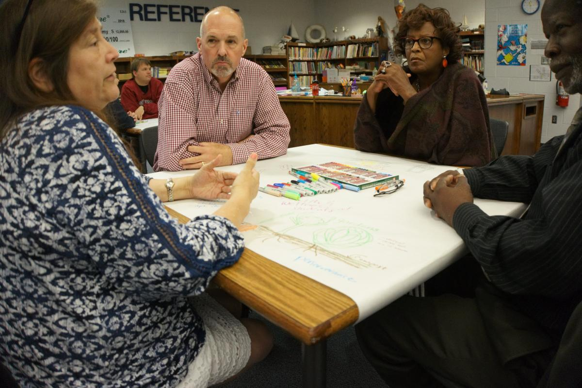 From left to right: Media Specialist Carla Clayton, Dr. Eric Groce, professor in the RCOE's Department of Curriculum & Instruction, 4th grade teacher Wanda McLemore, and Master Gardener Johnell Hunter, Sr. discuss the incorporation of sustainable initiatives into the Academy. Photo by Vachel Miller