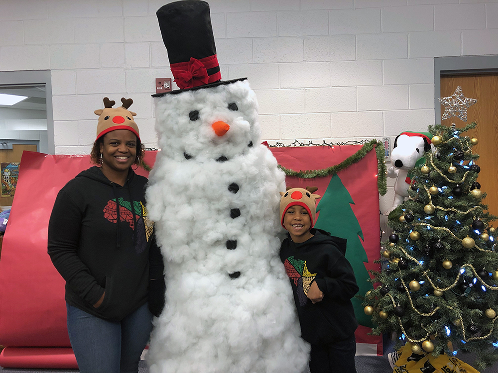 ESL teacher, parent and Appalachian reading education master's candidate, Chantae Reynolds, and her son, Jameson Kankula, pose for a picture with the Academy's very own Frosty (aka Physical Education teacher, Coach Phelps, who made the costume herself). Photo submitted
