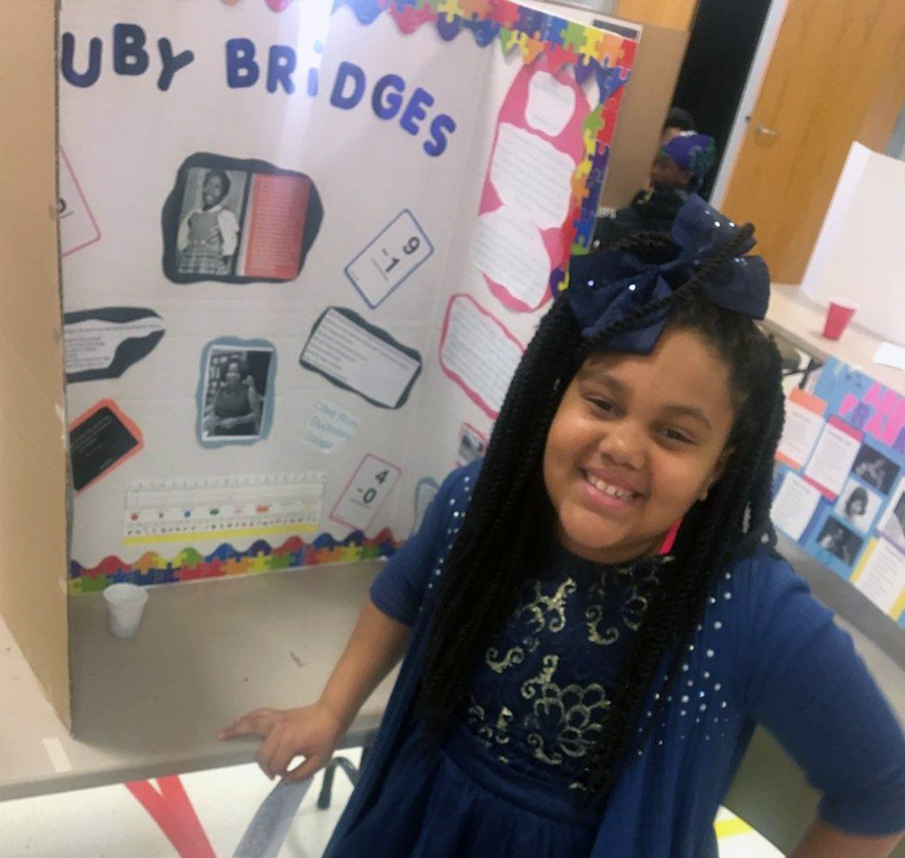 Amiya Crawford, 4th grade student at the Academy, researched Ruby Bridges and shared her story with students and staff at the Academy's Wax Museum.