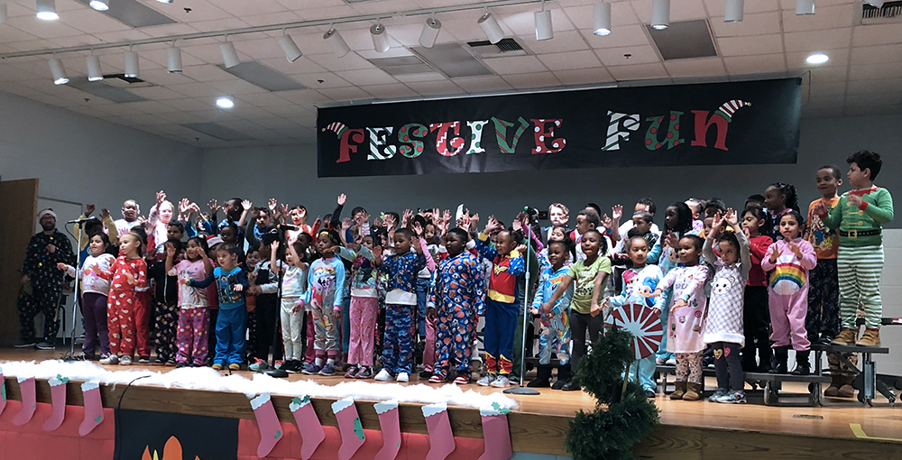 The Academy's kindergarten and 1st-grade students dance and sing during the first Fun Festive Program. Photo submitted