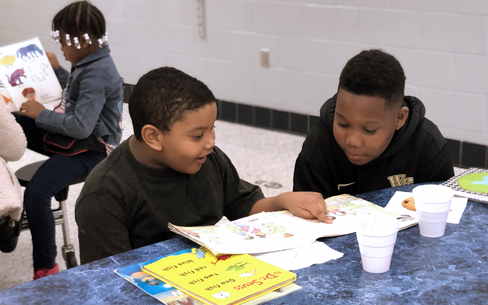 Adrian Haney (4th-grade) and Jhoan Mendez-Candela (1st-grade) read together during Spirit Week's Books and Buddies. Photo submitted