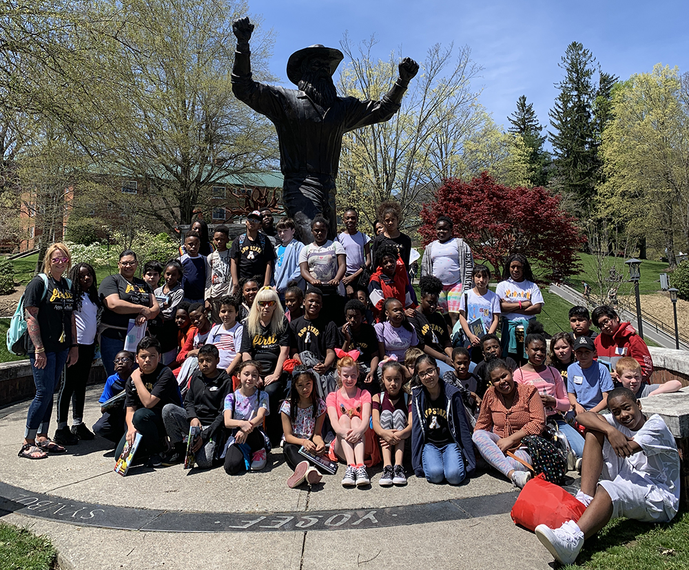 The group poses together for a photo with Yosef. Photo by Tracey Tardiff