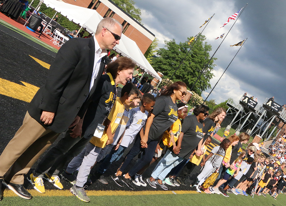 Students were recognized on the field and joined by Doug Gillin, Appalachian's Director of Athletics, and Dr. Melba Spooner, Dean of the RCOE. Photo by Heather Brandon