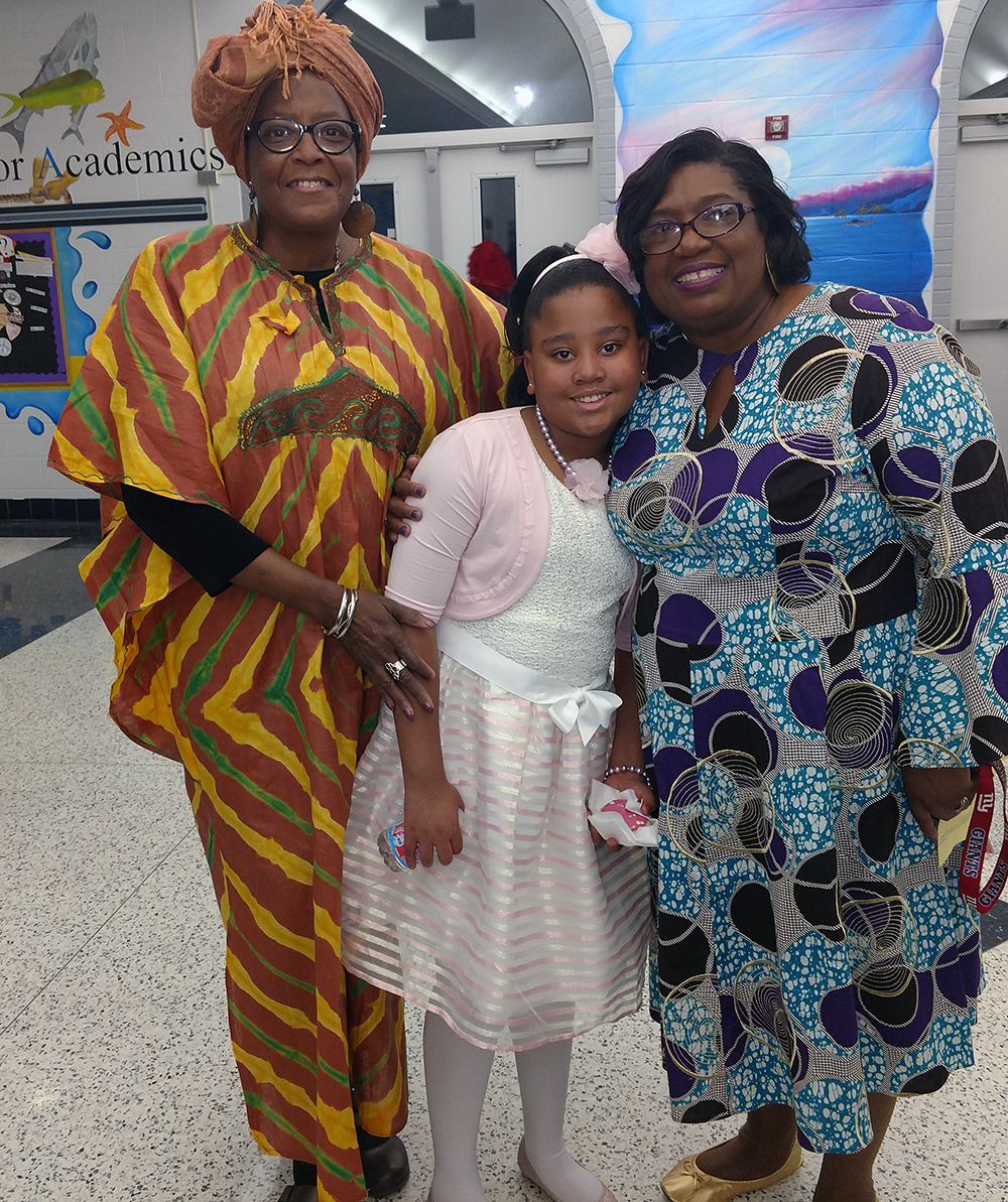 Wanda McLemore, 4th grade teacher, and Verschello Nelson, Academy Assistant Principal, celebrate the accomplishments of Maelaya Little after her performance in the Academy's, A World without Color.
