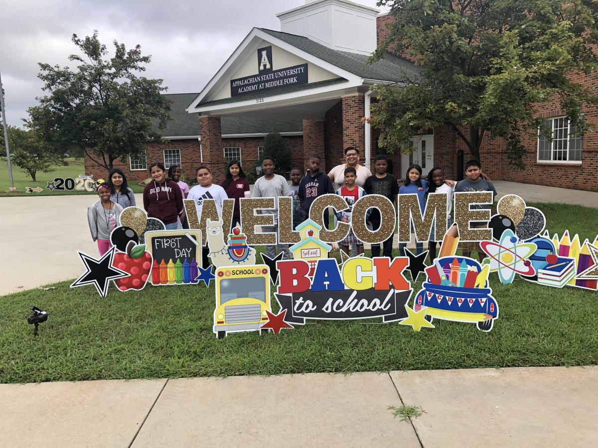 Fifth grade teacher Monique Johnson poses with her class outside the Academy on the first day of the 2019-20 school year. Photo by Amie Snow
