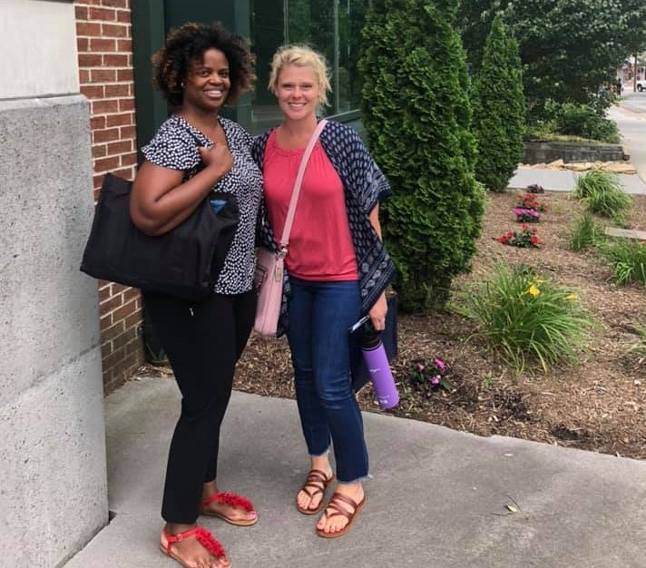 Reynolds (left) and Trainor (right) pose outside of the Turchin Center for the Visual Arts on the first day of their doctoral program at Appalachian. Photo by Amie Snow